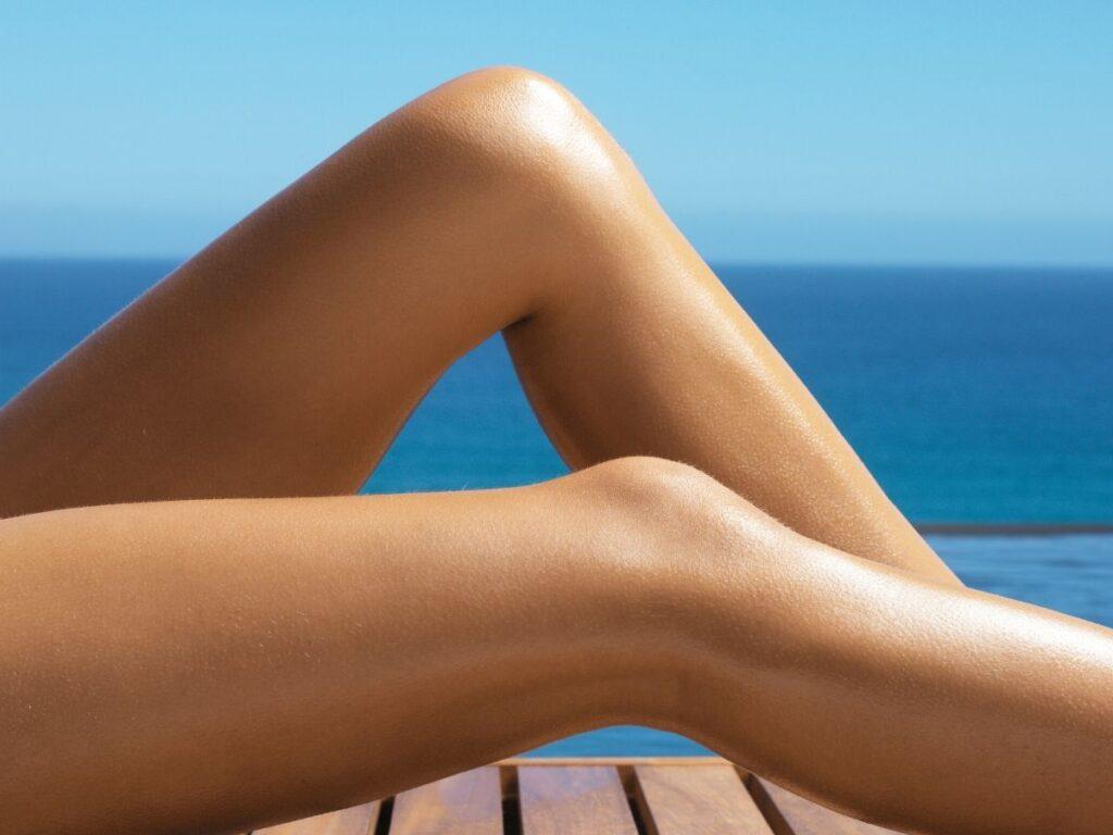 woman's legs sunbathing