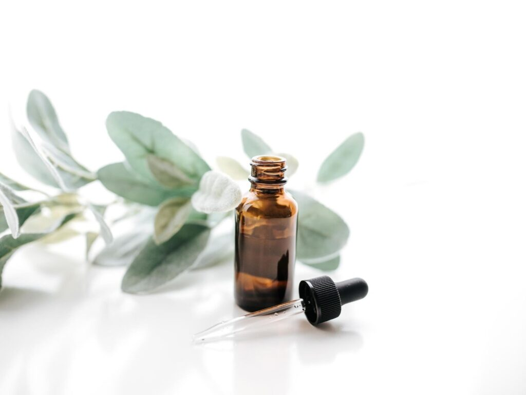 sage essential oils with high frequency on table