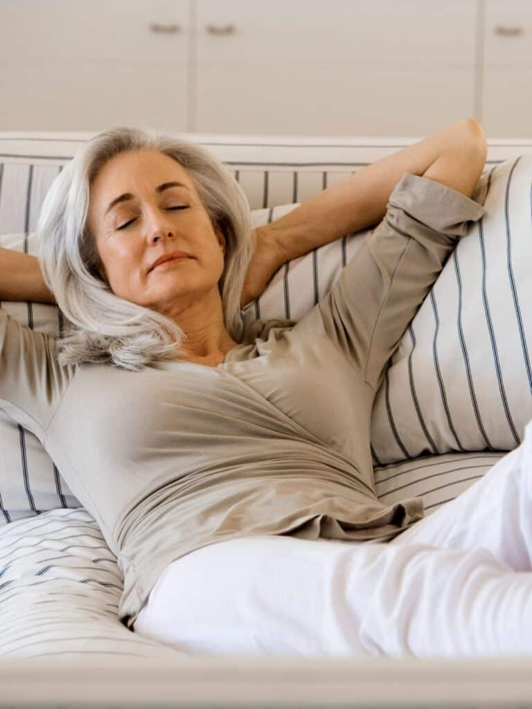 woman relaxing on a couch.