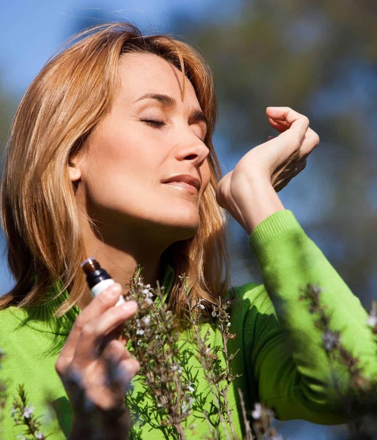 Woman inhaling essential oils on her wrist.
