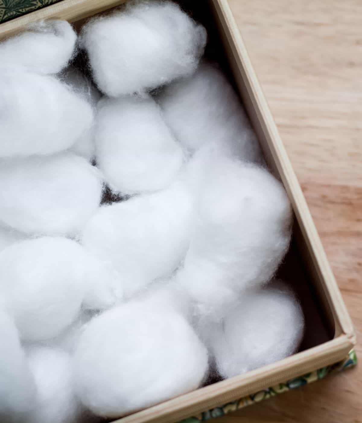 Cotton balls in container ready to diffuse.